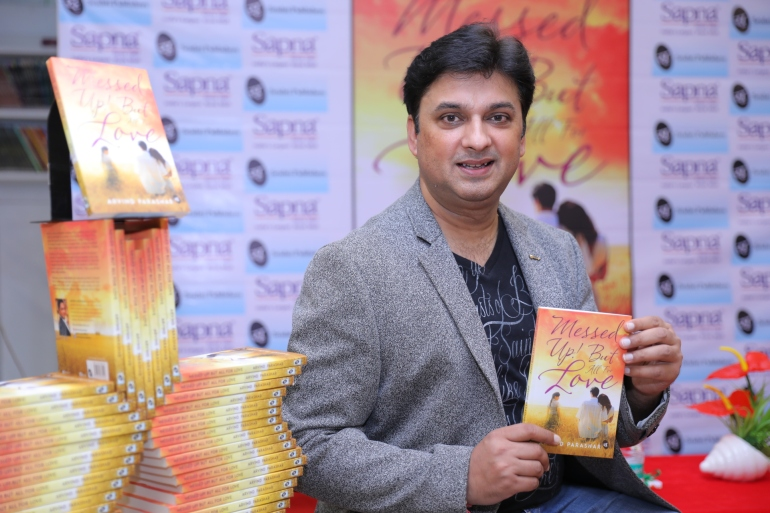Arvind Parashar with his book messed up but all for love